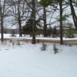 The view of the front yard and river valley with snow on the ground