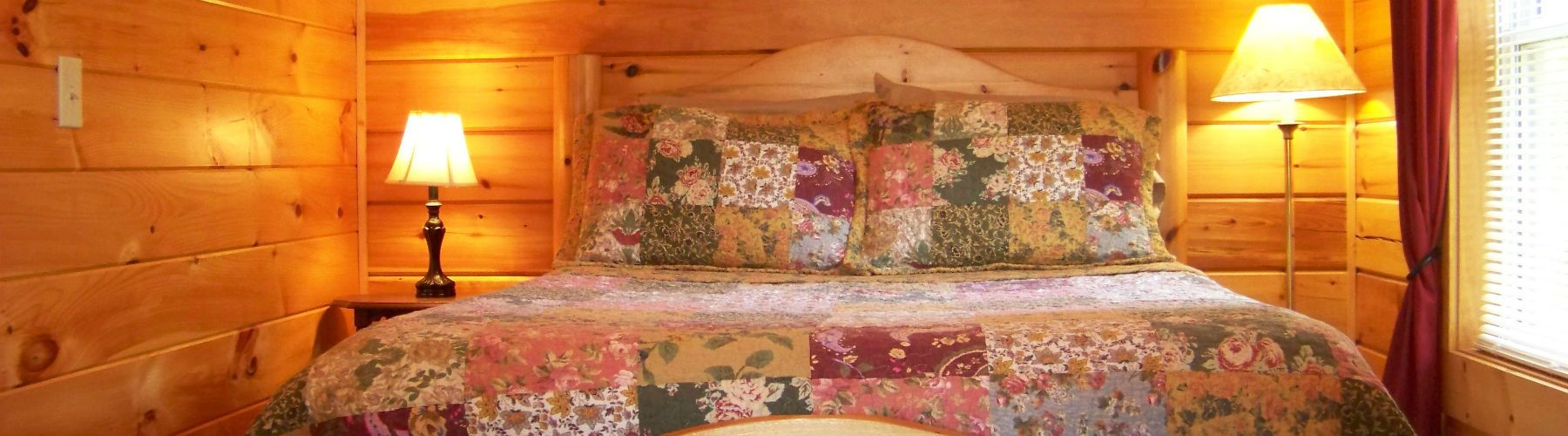 The bedroom in Jack's Little Log Cabin.